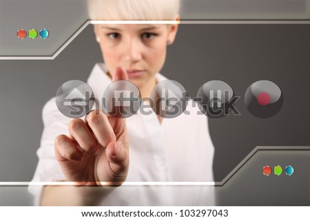 Girl with multimedia center - touching screen entertainment center - stock photo