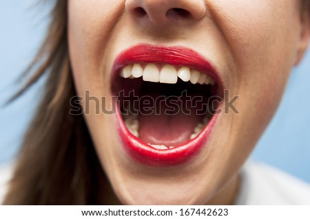 Girl with opened mouth - stock photo