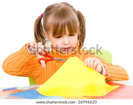 girl with paper and scissors isolated on white - stock photo