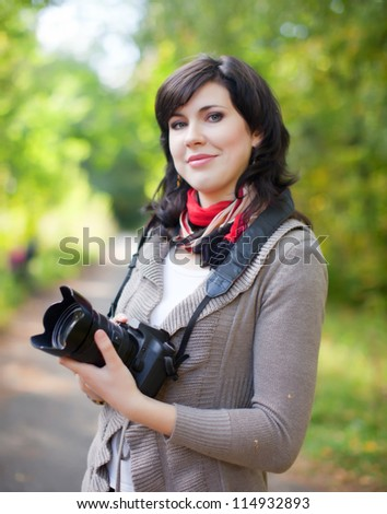 girl with photocamera at september park - stock photo