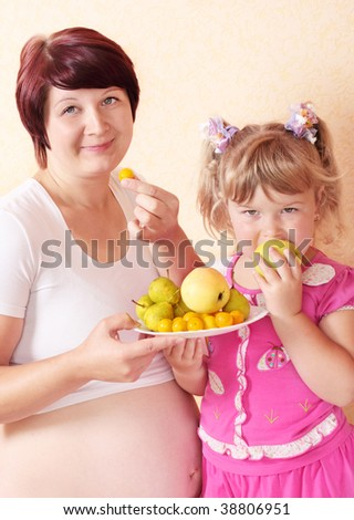 girl with pregnant woman - stock photo