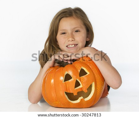 girl with pumpkin on white - stock photo