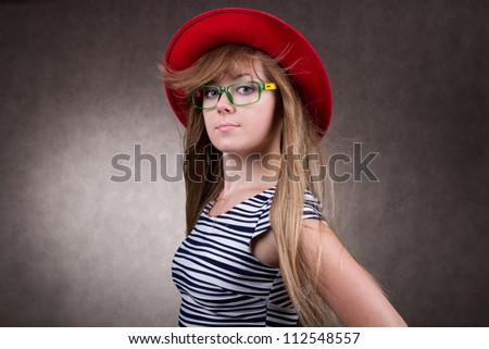 girl with red cap and eyeglasses - stock photo