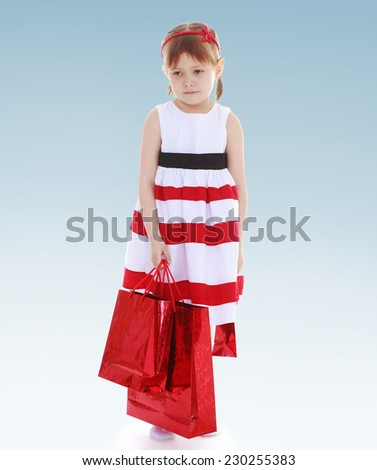 Girl with red packets.charming little girl.Happy childhood, teens concept. - stock photo