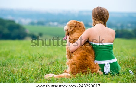 Girl with retriever - stock photo