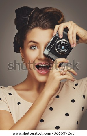 Girl with retro camera - stock photo