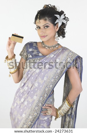Girl with rich-fancy sari holding credit card - stock photo