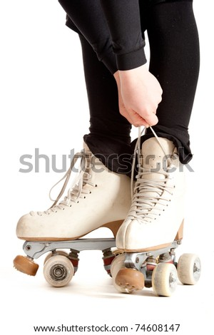 girl with roller skates isolated on white background - stock photo