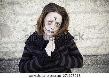 Girl with satanic and gothic cross, halloween - stock photo