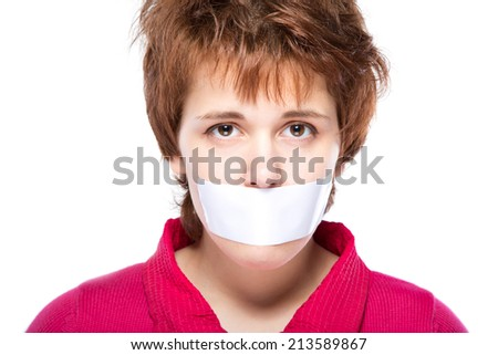 girl with self-adhesive tape over her mouth - stock photo