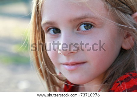 Girl with serene look - stock photo