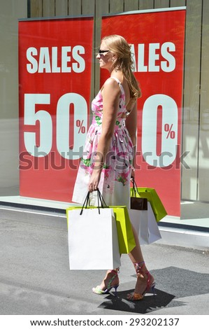Girl with shopping bags at the sale - stock photo