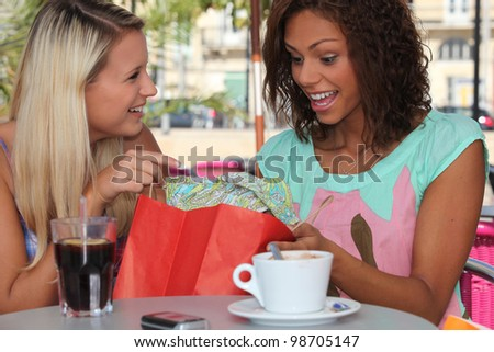Girl with shopping bags on bar terrace - stock photo