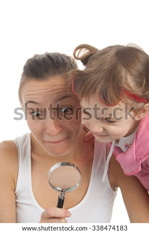 Girl with silly face with magnifier. Isolated on white background. - stock photo