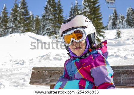 Girl with ski goggles and helmet - stock photo