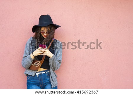 girl with smartphone on street - stock photo