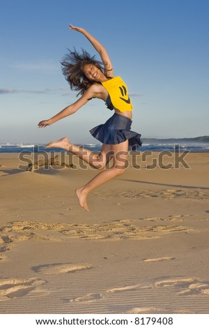 Girl with smily face top on jumping in the air - stock photo
