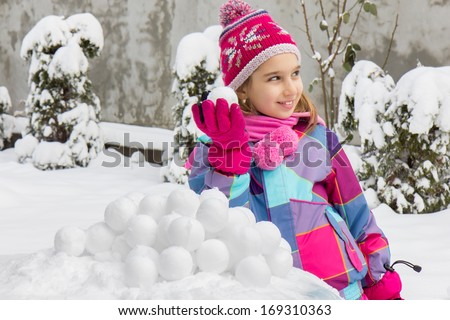 Girl with snowballs   - stock photo
