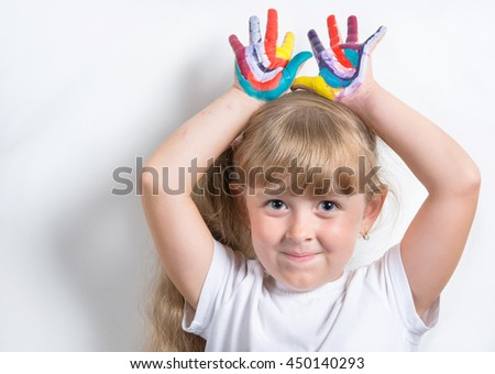 girl with soiled paint palms - stock photo