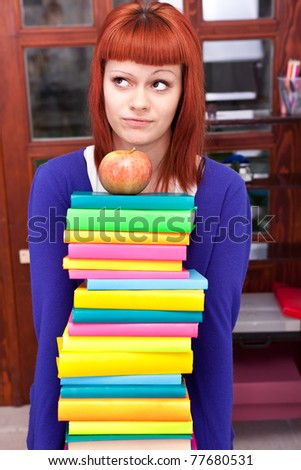 girl with stack color book, thinking about learning - stock photo