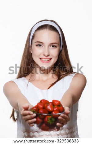 Girl with strawberries, healthy food, happy - stock photo