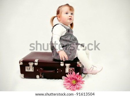 girl with suitcase - stock photo