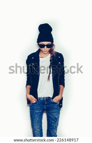 Girl  with sunglasses looking at floor.  White background, toned, not isolated - stock photo