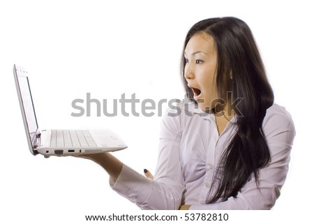 girl with surprise looks at the laptop - stock photo