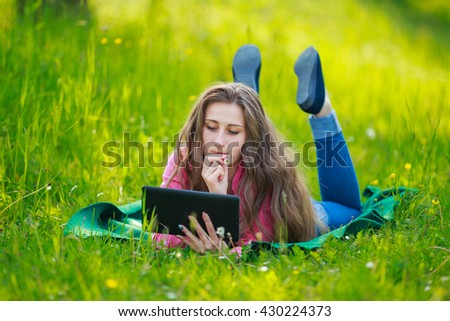 Girl with tablet computer - stock photo