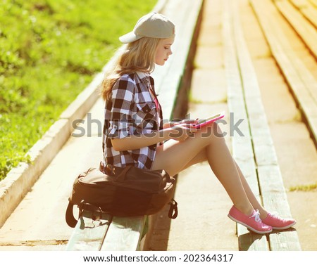 Girl with tablet pc working in the city park, student, education, modern youth - concept - stock photo