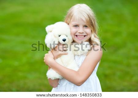 girl with teddy bear - stock photo