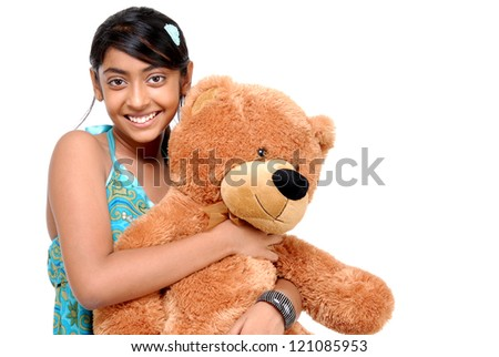 Girl with Teddy bear in an embrace - stock photo