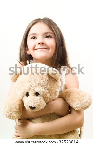 Girl with Teddy-bear in an embrace - stock photo