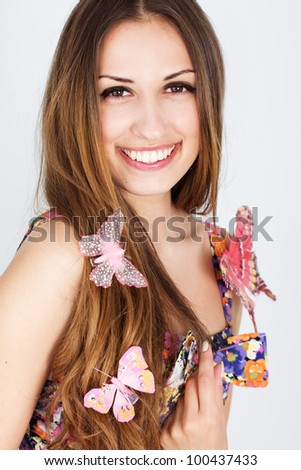girl with the beautiful butterflies on her hair - stock photo