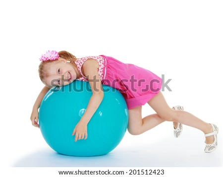 Girl with the big ball on white background.happy childhood,sweet child having fun outdoor,playing isolated on white background, happiness concept,adorable child having fun in studio - stock photo