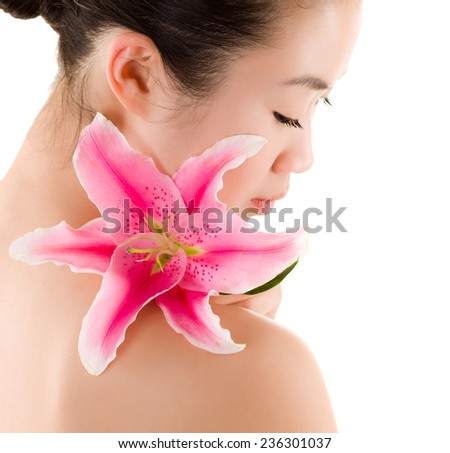 Girl with the lily sitting in studio. white background. - stock photo