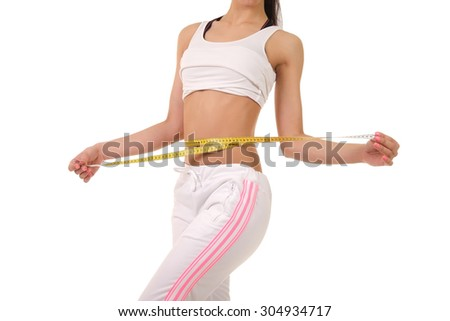 girl with the measuring tape. studio photo - stock photo