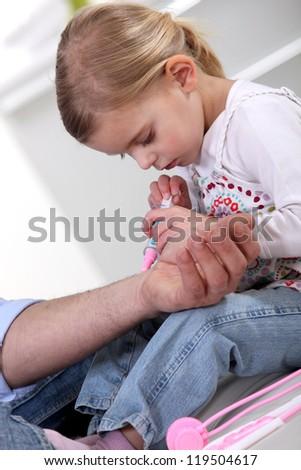 Girl with toy syringe - stock photo