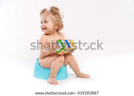 girl with toys on the pot - stock photo