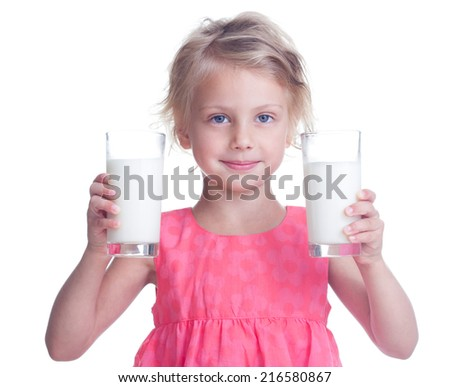 Girl with two glasses of milk in hand - stock photo