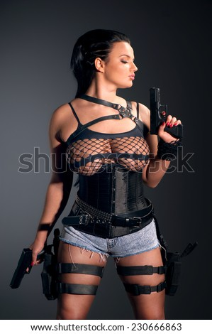 Girl with two guns - stock photo