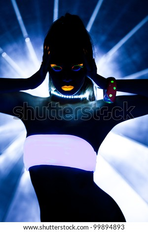 Girl with ultraviolet make-up disco dance - stock photo