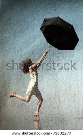 girl with umbrella at the beach. Photo in old color image style. - stock photo