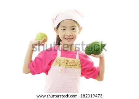 Girl with vegetables  - stock photo
