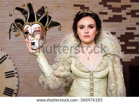 Girl with venetian mask in hand - stock photo