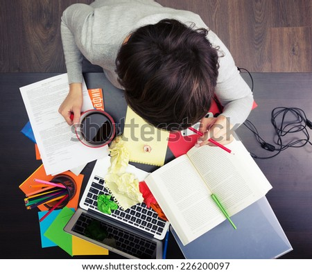 Girl working at the creative workplace - stock photo