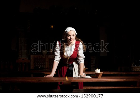 Girl working in the  medieval restaurant in Tallinn, Estonia, Europe - stock photo