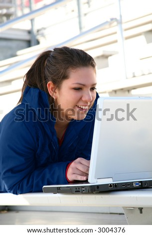 girl working on her laptop outside - stock photo