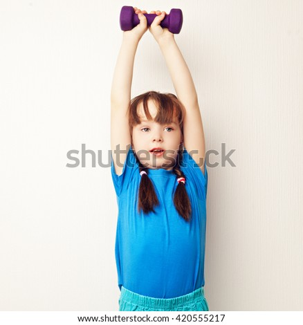 girl working out with dumbbells at home - stock photo
