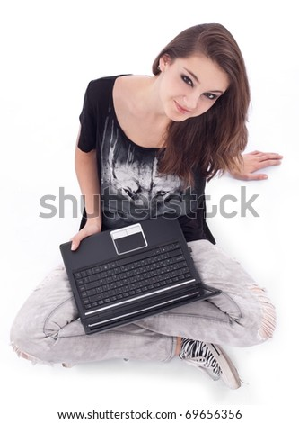 Girl working with laptop. Picture on a white background. - stock photo